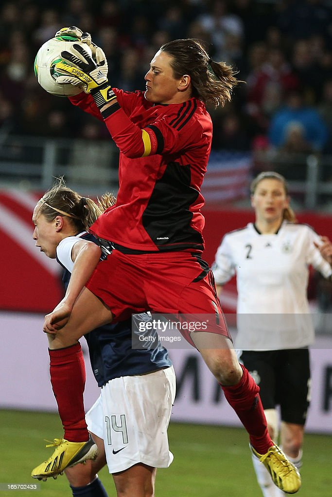 Goalkeeper <a gi-track='captionPersonalityLinkClicked' href=/galleries/search?phrase=Nadine+Angerer&family=editorial&specificpeople=2149437 ng-click='$event.stopPropagation()'>Nadine Angerer</a> of Germany makes a save against <a gi-track='captionPersonalityLinkClicked' href=/galleries/search?phrase=Whitney+Engen&family=editorial&specificpeople=7489472 ng-click='$event.stopPropagation()'>Whitney Engen</a> of the United States during the Women's International Friendly match between Germany and the United States at Sparda-Bank-Hessen-Stadion on April 5, 2013 in Offenbach, Germany.