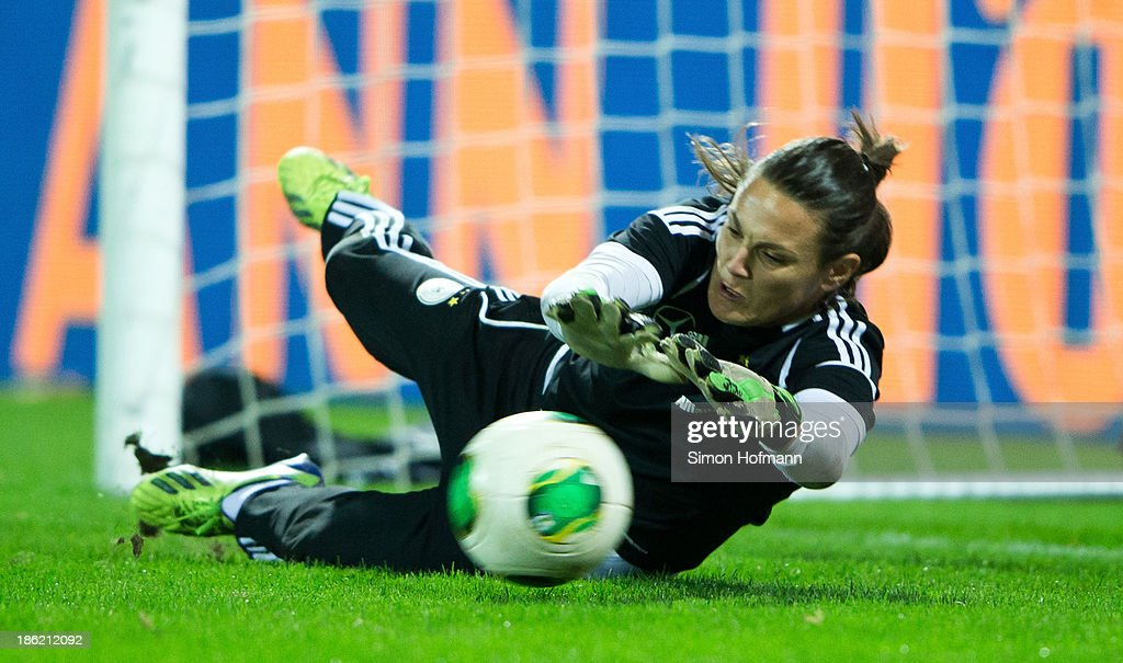 Goalkeeper Nadine Angerer of Germany makes a save during a Germany training session at Volksbank Stadion on October 29, 2013 in Frankfurt am Main, Germany.