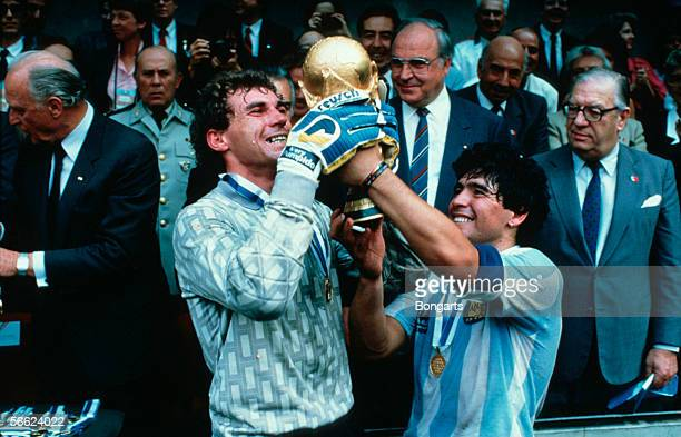 Goalkeeper Nery Pumpido and Diego Maradona of Argentina with the Trohpy after the World Cup final match between Argentina and Germany on June 29 1986...