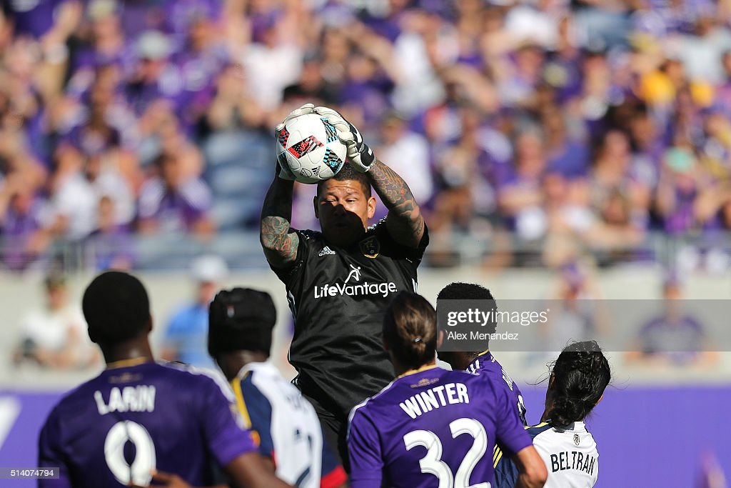 Goalkeeper Nick Rimando #18 of Real Salt Lake makes a leaping save during a MLS soccer match between Real Salt Lake and the Orlando City SC at the Orlando Citrus Bowl on March 6, 2016 in Orlando, Florida. The game ended in a 2-2 draw.