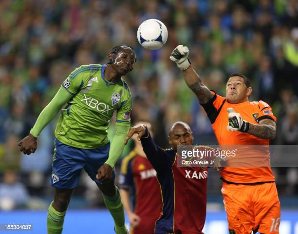 Goalkeeper Nick Rimando of Real Salt Lake punches away a shot by Jhon Kennedy Hurtado of the Seattle Sounders FC at CenturyLink Field on November 2...