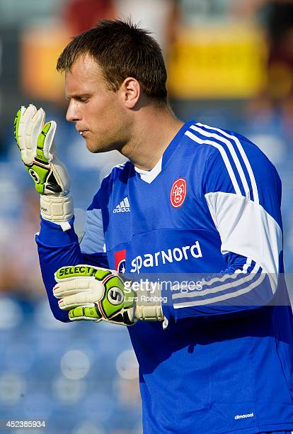 Goalkeeper Nicolai Larsen of AaB Aalborg spits in his gloves during the Danish Superliga match between Sonderjyske and AaB Aalborg at Sydbank Arena...