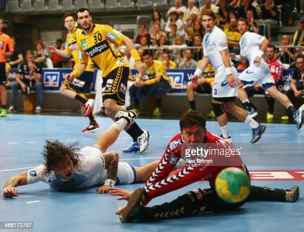 Goalkeeper Niklas Landin Jacobsen of RheinNeckar Loewen makes a save against Andreas Nilsson of Hamburg during the DKB Handball Bundesliga match...