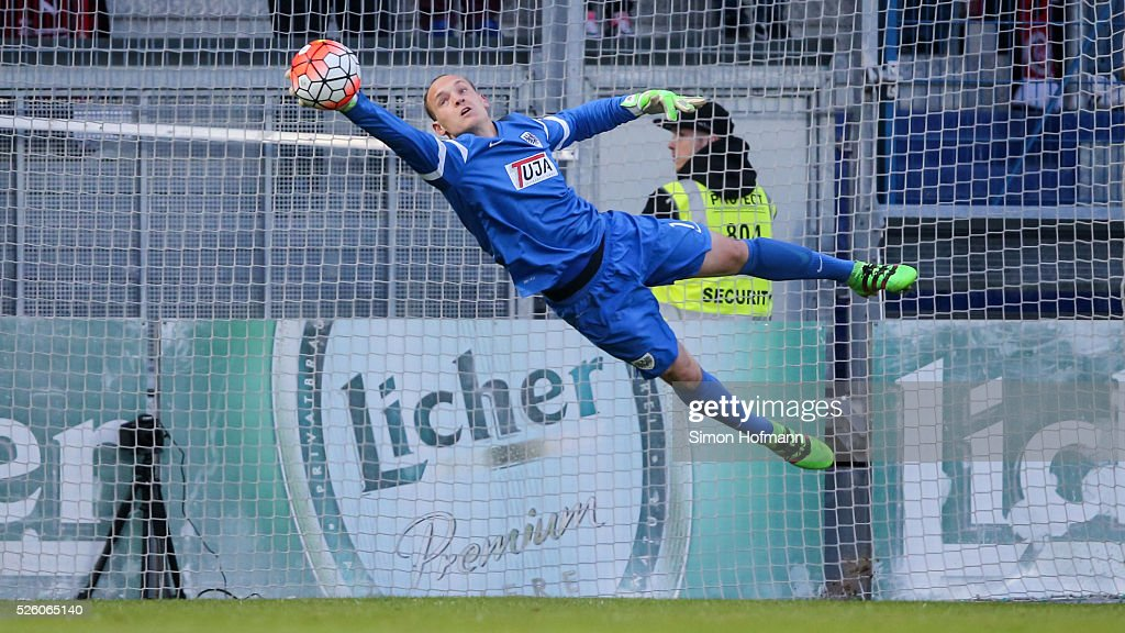 Goalkeeper Niklas Lomb of Muenster makes a save during the Third League match between Wehen Wiesbaden and Preussen Muenster at BRITA-Arena on April 29, 2016 in Wiesbaden, Hesse.