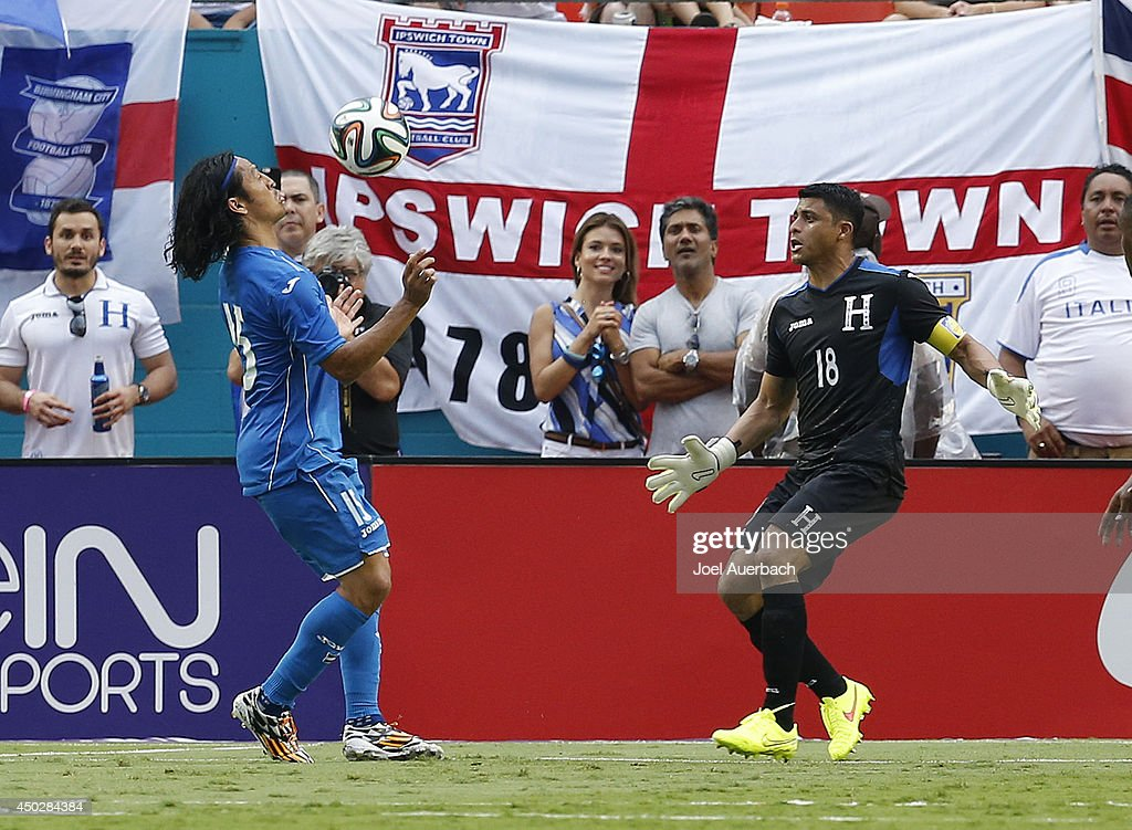 Goalkeeper Noel Valladares #18 looks on as Roger Espinoza #15 of Honduras controls the ball next to the goal against England on June 7, 2014 during an International friendly match at SunLife Stadium in Miami Gardens, Florida. The game ended in a 0-0 tie.