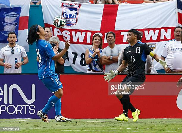 Goalkeeper Noel Valladares looks on as Roger Espinoza of Honduras controls the ball next to the goal against England on June 7 2014 during an...