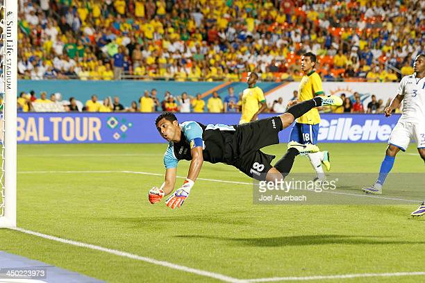 Goalkeeper Noel Valladares of Honduras dives towards the net but the ball shot by Brazil goes wide on November 16 2013 during a friendly match at...