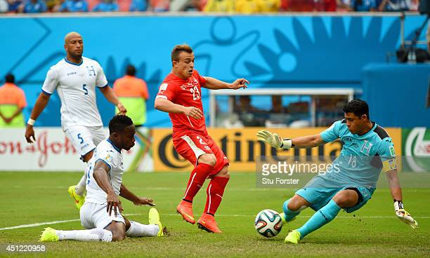 Goalkeeper Noel Valladares of Honduras makes a save at a goal attempt by Xherdan Shaqiri of Switzerland during the 2014 FIFA World Cup Brazil Group E...