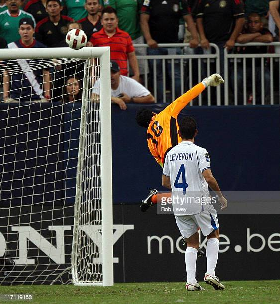 Goalkeeper Noel Valladares of Honduras tips the ball over the crossbar as Johnny Leveron looks on at Reliant Stadium on June 22 2011 in Houston Texas