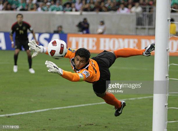 Goalkeeper Noel Valladares of Honduras watches as the shot sails just wide and off the post during the match against Mexico at Reliant Stadium on...