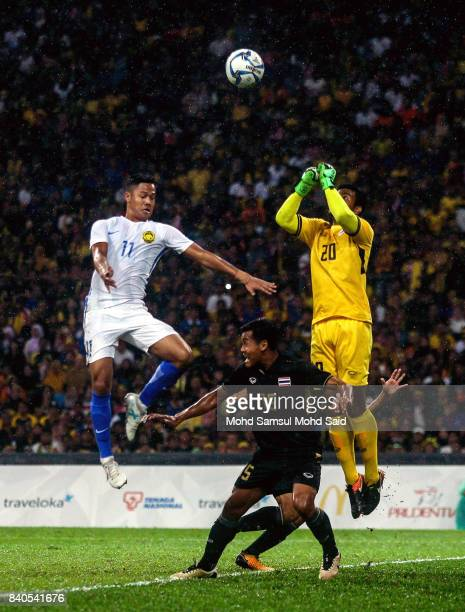 Goalkeeper Nont Muangngam of Thailand saves the ball during the Men's Football Final between Malaysia and Thailand at the Shah Alam Stadium as part...