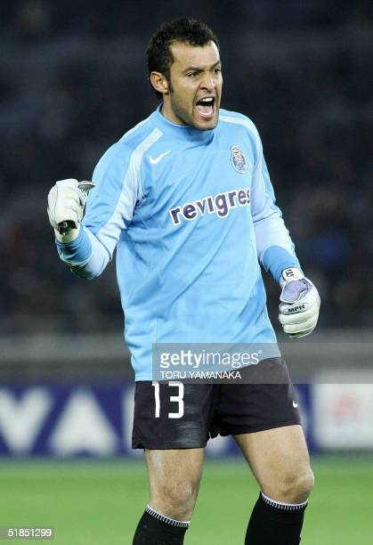 Goalkeeper Nuno of Portugese club FC Porto reacts when he stops a penalty kick in the Intercontinental Cup football in Yokohama 14 December 2004 The...