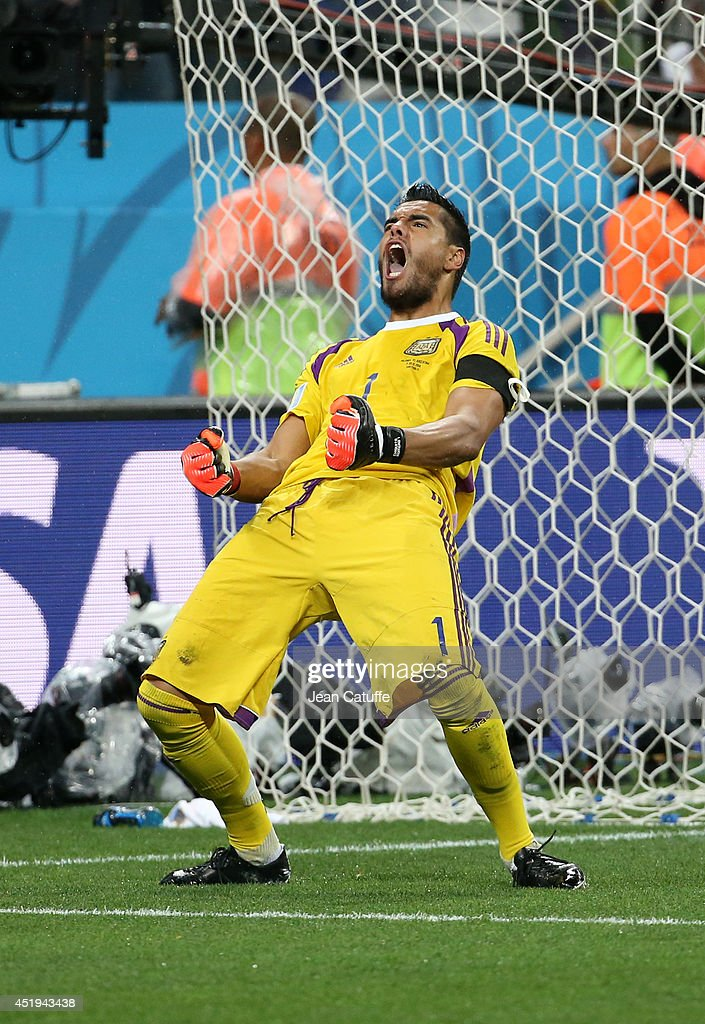 Goalkeeper of Argentina Sergio Romero reacts after saving a penalty during the penalty shootout at the end of the 2014 FIFA World Cup Brazil Semi Final match between Netherlands and Argentina at Arena de Sao Paulo on July 9, 2014 in Sao Paulo, Brazil.