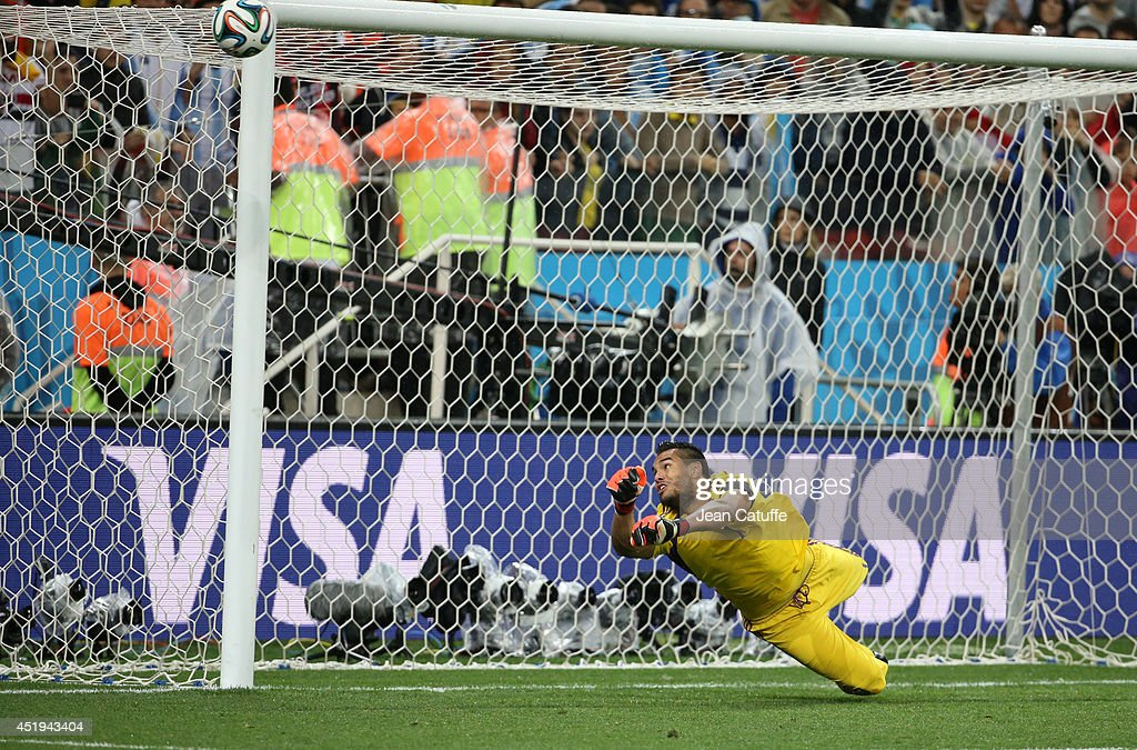 Goalkeeper of Argentina Sergio Romero stops the penalty kick by Wesley Sneijder of the Netherlands in the penalty shootout during the 2014 FIFA World Cup Brazil Semi Final match between Netherlands and Argentina at Arena de Sao Paulo on July 9, 2014 in Sao Paulo, Brazil.