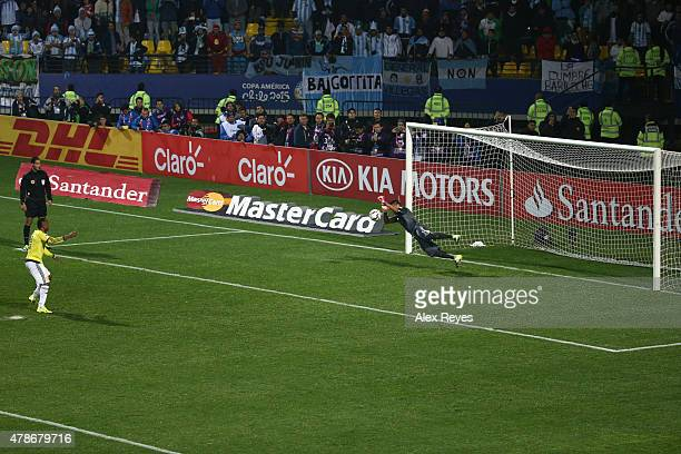 Goalkeeper of Argentina Sergio Romero stops the sixth penalty kick by Camilo Zuñiga of Colombia in the penalty shootout during the 2015 Copa America...