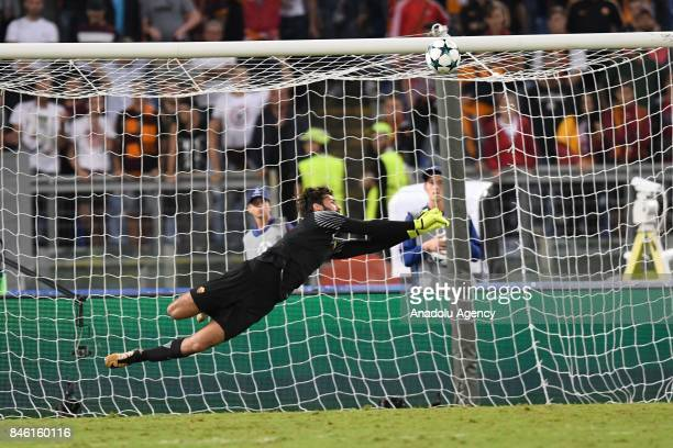 Goalkeeper of AS Roma Becker Allison in action during the UEFA Champions League group C soccer match between AS Roma and Club Atletico de Madrid at...