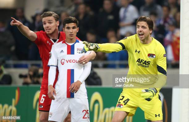 Goalkeeper of AZ Alkmaar Tim Krul and Ben Rienstra of AZ Alkmaar react while Houssem Aouar of Lyon looks on during the UEFA Europa League Round of 32...