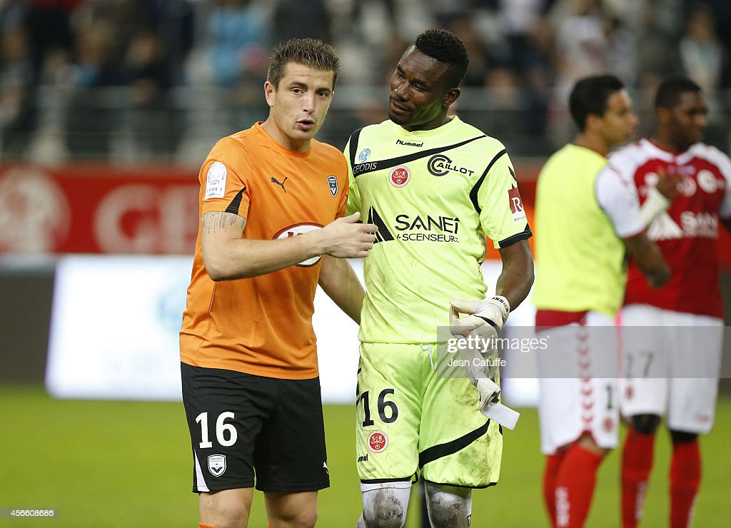 Goalkeeper of Bordeaux <a gi-track='captionPersonalityLinkClicked' href=/galleries/search?phrase=Cedric+Carrasso&family=editorial&specificpeople=661919 ng-click='$event.stopPropagation()'>Cedric Carrasso</a> talks to goalkeeper of Reims Kossi Agassa after during the French Ligue 1 match between Stade de Reims and FC Girondins de Bordeaux at the Stade Auguste Delaune on October 3, 2014 in Reims, France.