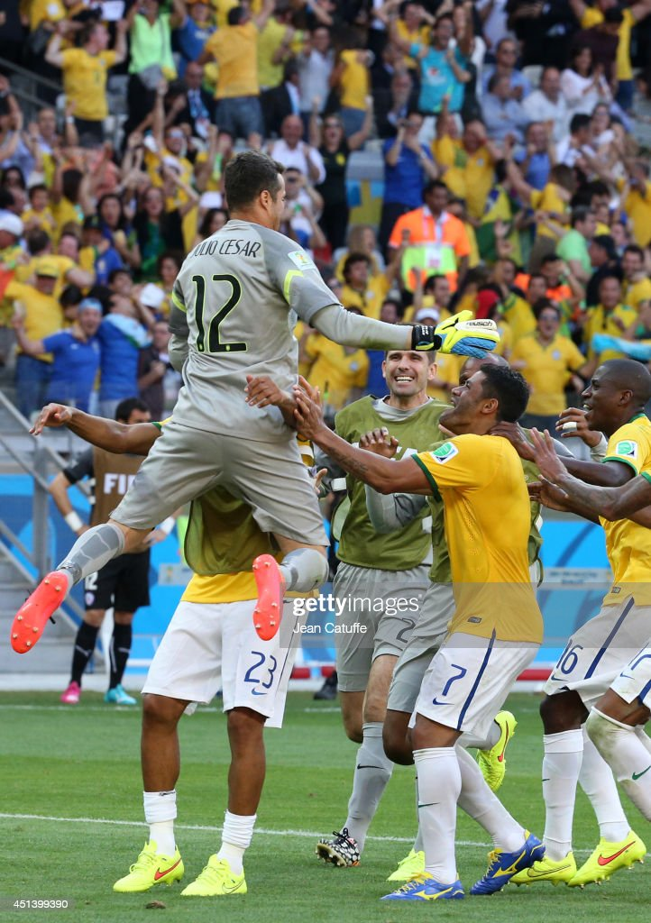 Goalkeeper of Brazil Julio Cesar is celebrated by his teammates after winning a penalty shootout during the 2014 FIFA World Cup Brazil round of 16 match between Brazil and Chile at Estadio Mineirao on June 28, 2014 in Belo Horizonte, Brazil.
