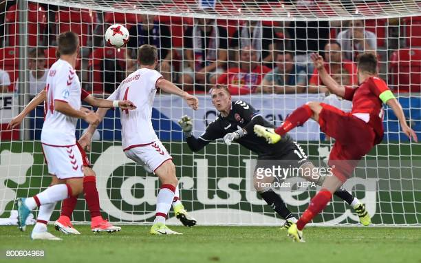 Goalkeeper of Denmark Jeppe Hojbjerg makes a save during the UEFA European Under21 Championship Group C match between Czech Republic and Denmark at...