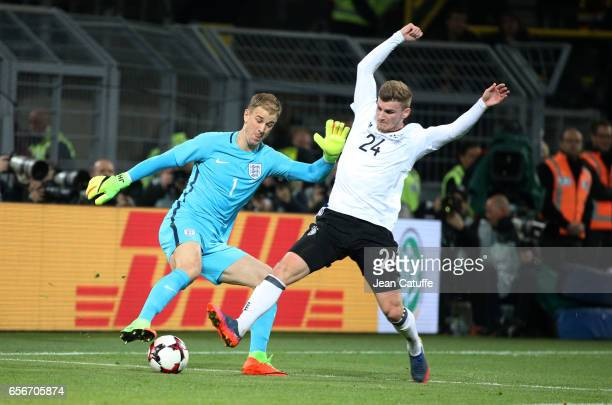 Goalkeeper of England Joe Hart and Timo Werner of Germany in action during the international friendly match between Germany and England at Signal...