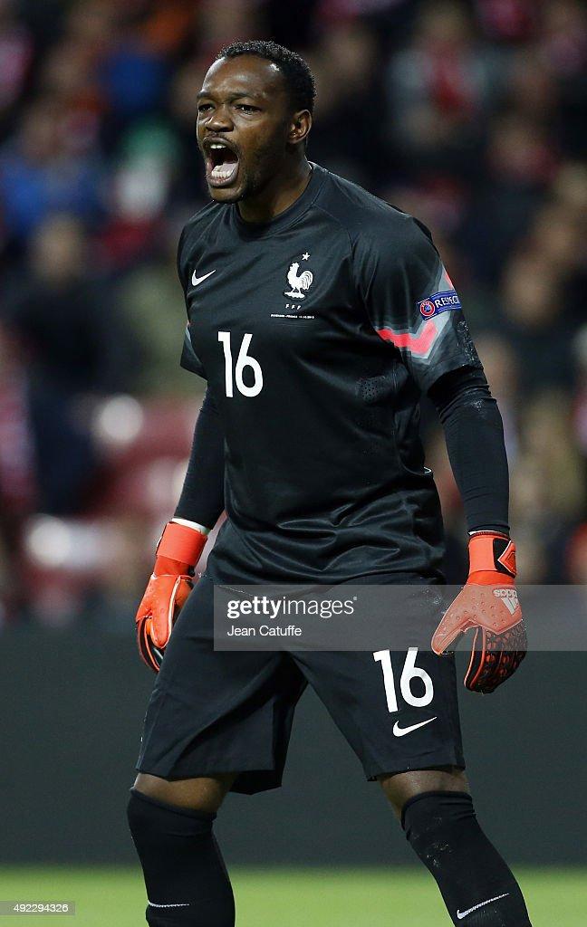 Goalkeeper of France Steve Mandanda reacts during the international friendly match between Denmark and France at Telia Parken Stadium on October 11...