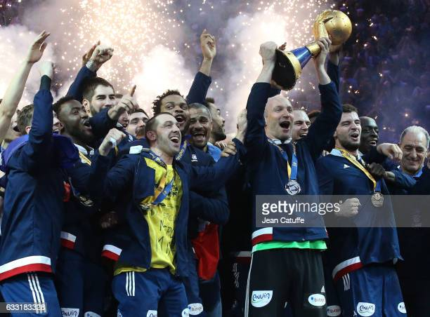 Goalkeeper of France Thierry Omeyer holding the trophy celebrate with teammates the victory following the 25th IHF Men's World Championship 2017...