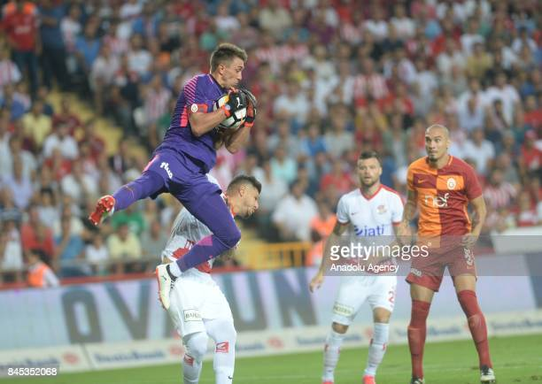 Goalkeeper of Galatasaray Muslera in action against Diego of Antalyaspor during the 4th week of the Turkish Super Lig match between Antalyaspor and...