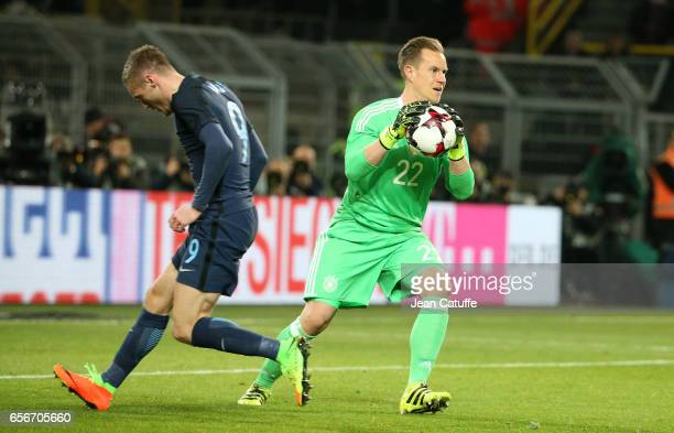 Goalkeeper of Germany MarcAndre ter Stegen in action while Jamie Vardy of England looks on during the international friendly match between Germany...