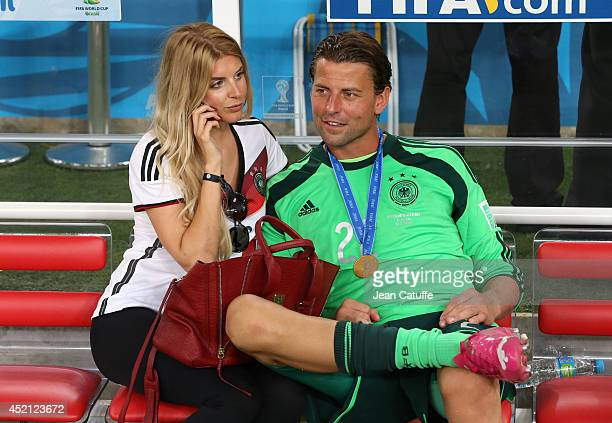 Goalkeeper of Germany Roman Weidenfeller and his girlfriend Lisa Rossenbach celebrate the victory after the 2014 FIFA World Cup Brazil Final match...