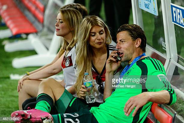 Goalkeeper of Germany Roman Weidenfeller and his girlfriend Lisa Rossenbach celebrate the victory in extra time during the 2014 FIFA World Cup Brazil...