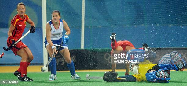 Goalkeeper of Great Britain saves an attempt by Fanny Rinne of Germany during their 2008 Olympics Games women's field hockey match in Beijing on...