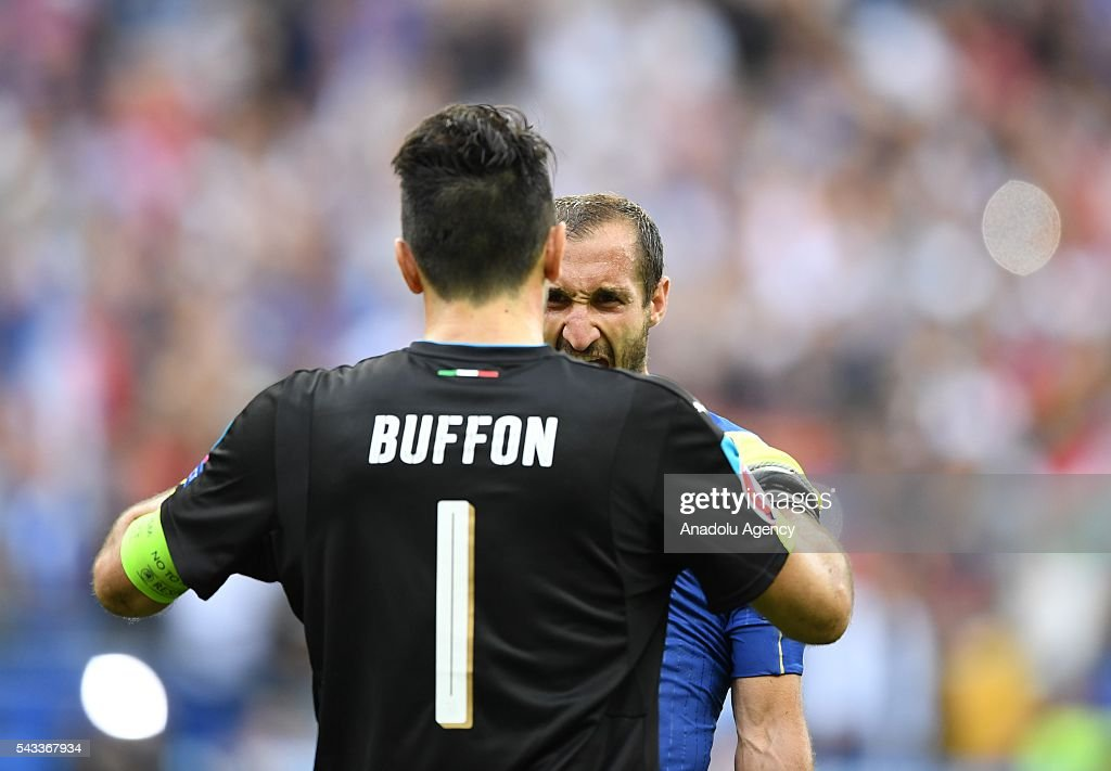 Goalkeeper of Italy Gianluigi Buffon (1) and Giorgio Chiellini (behind) celebrate after the UEFA Euro 2016 round of 16 football match between Italy and Spain at Stade de France in Paris, France on June 27, 2016.