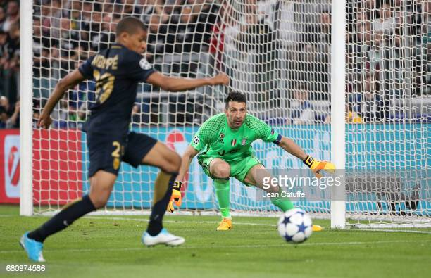 Goalkeeper of Juventus Gianluigi Buffon and Kylian Mbappe of Monaco in action during the UEFA Champions League semi final second leg match between...