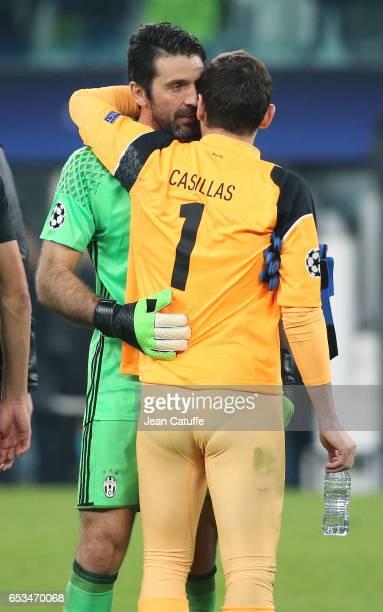 Goalkeeper of Juventus Gianluigi Buffon greets goalkeeper of FC Porto Iker Casillas following the UEFA Champions League Round of 16 second leg match...