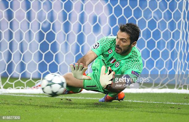 Goalkeeper of Juventus Gianluigi Buffon stops the penalty kick from Alexandre Lacazette of Lyon during the UEFA Champions League match between...