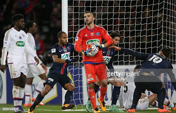 Goalkeeper of Lyon Anthony Lopes looks dejected while Zlatan Ibrahimovic of PSG celebrates scoring a goal with Lucas Moura and Edinson Cavani during...