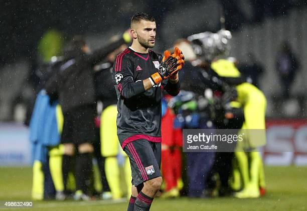 Goalkeeper of Lyon Anthony Lopes thanks the supporters while players of KAA Gent celebrate the victory following the UEFA Champions League match...