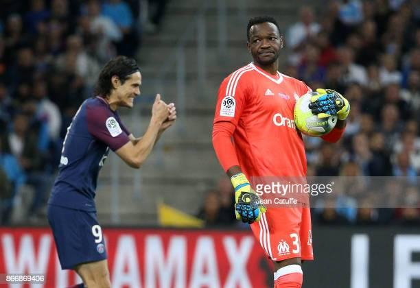 Goalkeeper of OM Steve Mandanda Edinson Cavani of PSG during the French Ligue 1 match between Olympique de Marseille and Paris Saint Germain at Stade...