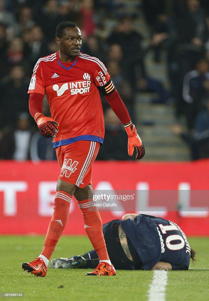 Goalkeeper of OM Steve Mandanda looks on after knocking down Zlatan Ibrahimovic of PSG during the French Ligue 1 match between Paris SaintGermain FC...