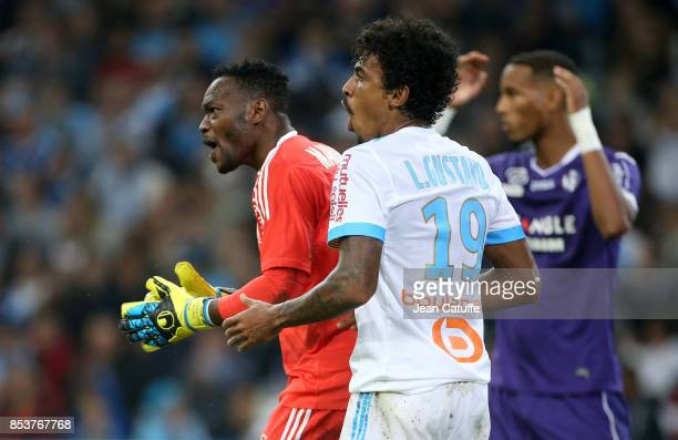 Goalkeeper of OM Steve Mandanda Luiz Gustavo of OM during the French Ligue 1 match between Olympique de Marseille and Toulouse FC at Stade Velodrome...