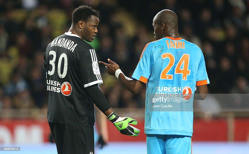 Goalkeeper of OM Steve Mandanda talks to Rod Fanni of OM during the French Ligue 1 match between AS Monaco FC v Olympique de Marseille OM at Stade...