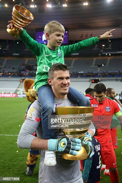 Goalkeeper of PSG Nicolas Douchez and his son celebrate the victory after the French League Cup final between Paris SaintGermain FC and Sporting Club...