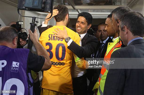 Goalkeeper of PSG Salvatore Sirigu and President of PSG Nasser AlKhelaifi celebrate the victory of PSG in French Ligue 1 Championship after their...