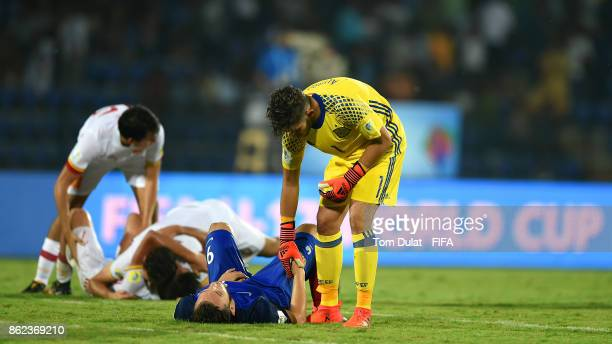 Goalkeeper of Spain Alvaro Fernandez comforts Amine Gouiri of France during the FIFA U17 World Cup India 2017 Round of 16 match between France and...