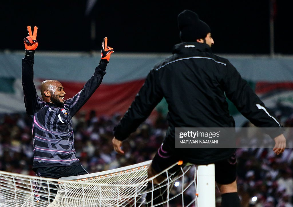 Goalkeeper of the United Arab Emirates' team, Ali Khussef Hamid, makes the sign of the victory sitting on his goal as he celebrates after his team won the final of the 21st Gulf Cup on January 18, 2013 in Manama. United Arab Emirates won 2-1 against Iraq.