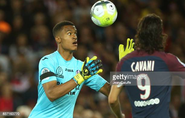 Goalkeeper of Toulouse Alban Lafont catches the ball in front of Edinson Cavani of PSG during the French Ligue 1 match between Paris Saint Germain...
