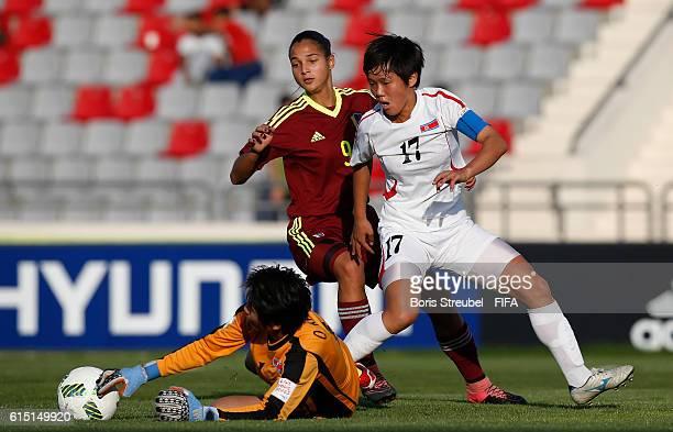Goalkeeper Ok Kum Ju of Korea DPR saves a ball against Deyna Castellanos of Venezuela during the FIFA U17 Women's World Cup Semi Final match between...