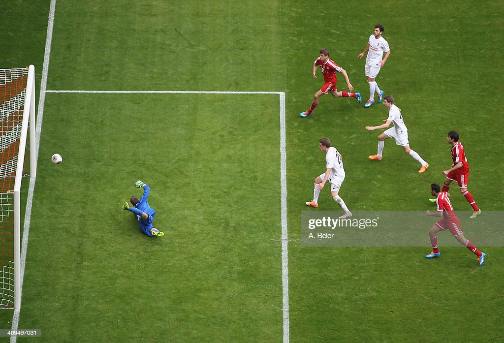 Goalkeeper <a gi-track='captionPersonalityLinkClicked' href=/galleries/search?phrase=Oliver+Baumann&family=editorial&specificpeople=4645207 ng-click='$event.stopPropagation()'>Oliver Baumann</a> (L) of Freiburg misses to save a shot of Dante (not in picture) during the Bundesliga match between FC Bayern Muenchen and SC Freiburg at Allianz Arena on February 15, 2014 in Munich, Germany.