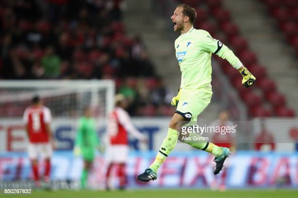 Goalkeeper Oliver Baumann of Hoffenheim celebrates after Mark Uth scored his team's third goal during the Bundesliga match between 1 FSV Mainz 05 and...